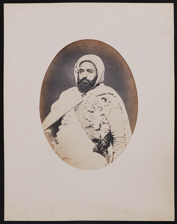 260. Emir Abd-el-Kader (57 years old) Born in Mascara (Oran province) (Algeria) Black hair, though he shaves his head daily; brown eyes, black beard with a few gray hairs. Son of Mouhi-Eddin and Zora; grandson of Moustapha ben Makta and Doha. Photographe