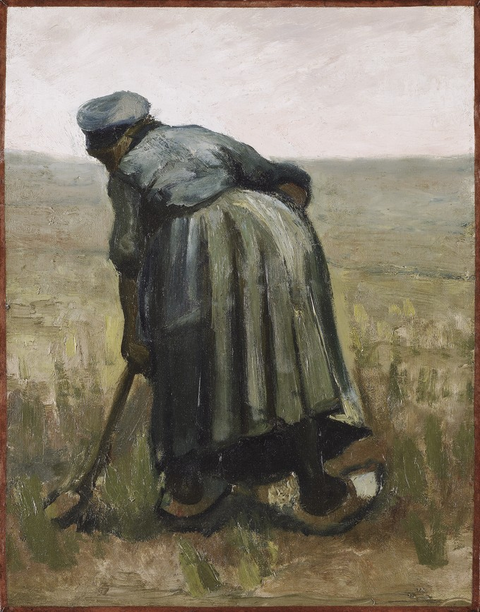 A woman with a spade, seen from behind